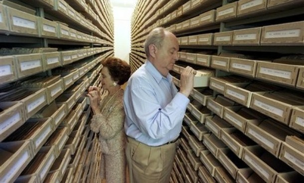 Gary Mokotoff, a Jewish genealogist from New Jersey, and Sallyann Sack from Bethesda, Md, take a look at name registers of victims of the Nazi regime at the International Tracing Service in Bad Arolsen, central Germany, Thursday, May 8, 2008. For decades after World War II, the files were only used to help find missing persons or document atrocities to support compensation claims. But in November, the last of the 11 countries that govern the archive under the auspices of the International Committee of the Red Cross, cleared the way for public access to the more than 50 million documents. Next month, a conference of historians is to meet here to map out the archive's unexplored contents and help determine how to best use the information in the future. (AP Photo/Michael Probst)