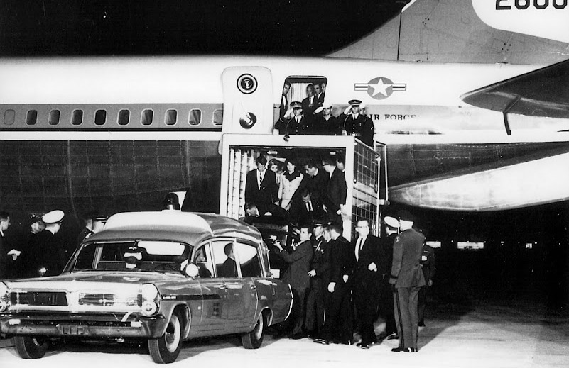 President John F. Kennedy's casket is loaded into Boeing VC-137C SAM 26000 (Air Force One) after his assassination in Dallas, Texas, in November 1963. (U.S. Air Force photo)