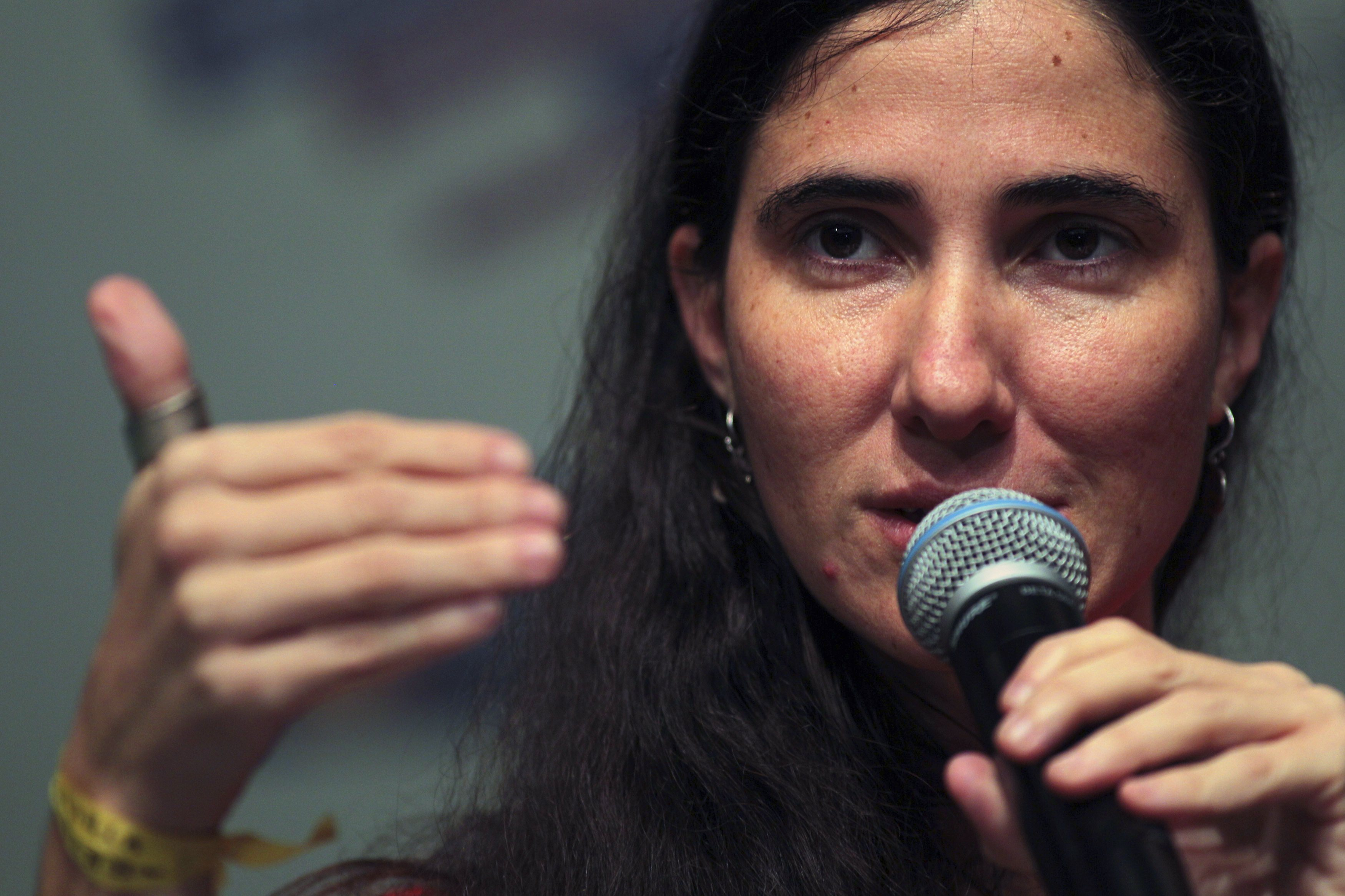 Cuba's best-known dissident, blogger Yoani Sanchez, addresses a news conference in Feira de Santana