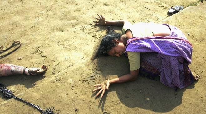 REUTERS PICTURES OF THE DECADE. An Indian woman mourns the death of her relative (L) who was killed in a tsunami on Sunday in Cuddalore, some 180 kilometres (112 miles) south of the southern Indian city of Madras December 28, 2004. REUTERS/Arko Datta (INDIA)