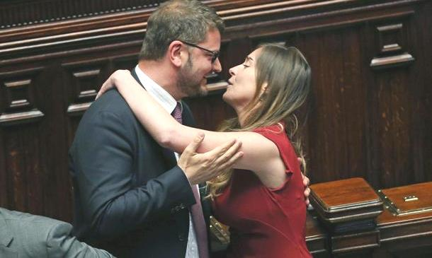 Maria Elena Boschi abbraccia Gennaro Migliore al termine del voto finale sulla riforma della legge elettorale, Roma, 4 maggio 2015. ANSA/ALESSANDRO DI MEO